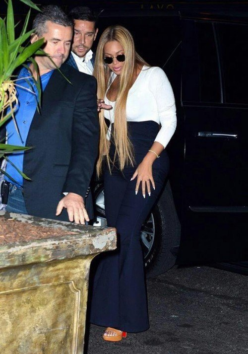 Beyonce pictured wearing the Flare Pant in Stretch Dark Denim